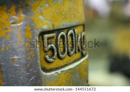 500kg weight close up with distressed paint