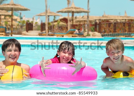 Kids by the pool - stock photo