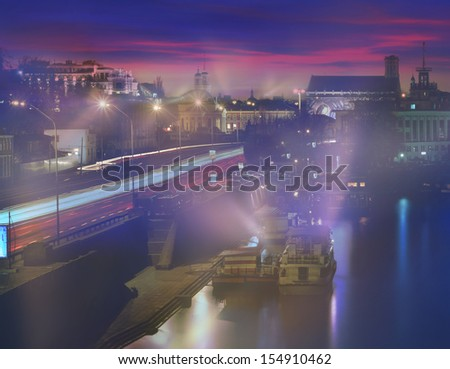 Kiev sunset on the Dnieper River, overlooking the River Station and the entire Podol, a transport line, old and new houses Roman Mikhailyuk