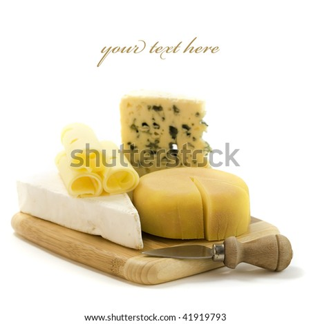 4 kinds of cheese with a cheese knife. With sample text - stock photo