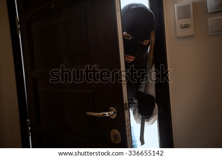 knife home burglary thief is breaking into a home - stock photo