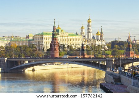Kremlin fortress with palace and cathedrals and Big Stone bridge on Moscow-river in Moscow, Russia. - stock photo