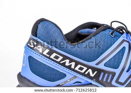 Kuala Lumpur, Malaysia, 10 September 2017- Salomon Speedcross3 trail running shoe on white background.The Salomon Group is a famous sports equipment manufacturing company.Selective focus.