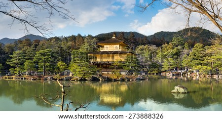 Kyoto, Japan- March 2, 2015 : Panorama view of  Golden Pavilion ( Kinkakuji ), one of the most famous temple in Kyoto. - stock photo