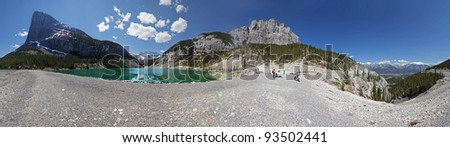 360, (l-r) Ha Ling Peak, Reservoir of water that transports water to Canmore, East Rundle Mountain, Valley that leads back to the Rock Wall and Grassi Lakes, then to the Parking Lot. Alberta, Canada. - stock photo
