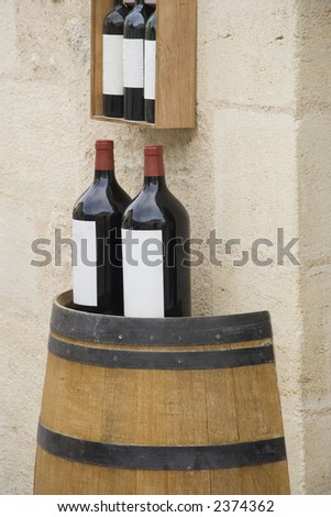 3l wine bottles on a wine cask - saint-emilion, france - stock photo