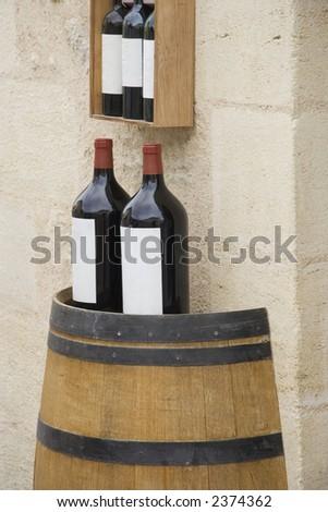 3l wine bottles on a wine cask - saint-emilion, france - stock photo