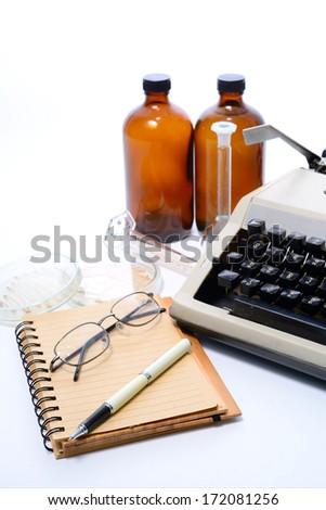 laboratory glassware and book. - stock photo