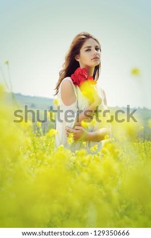 lady in blossom raps field in retro style - stock photo