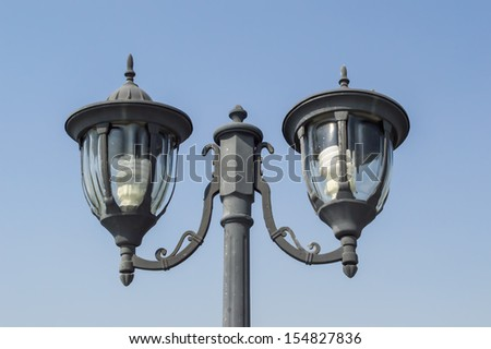 lamp post with blue sky - stock photo