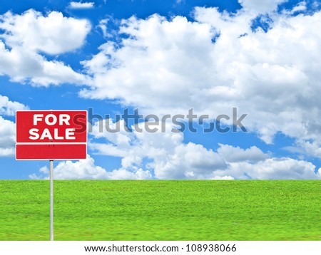 """""""LAND FOR SALE SIGN"""" on empty meadow - Real estate conceptual image - stock photo"""