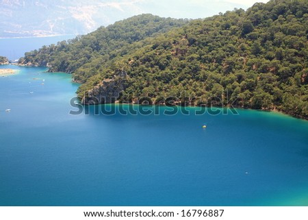 landscape view of a beautiful bay with forest - stock photo