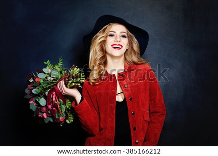 Laughing Woman with Flowers - stock photo