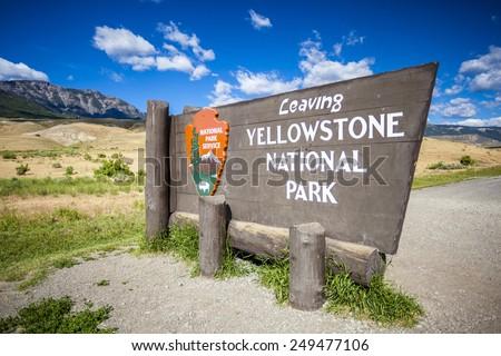 'Leaving Yellowstone National Park' Sign, Montana, USA - stock photo