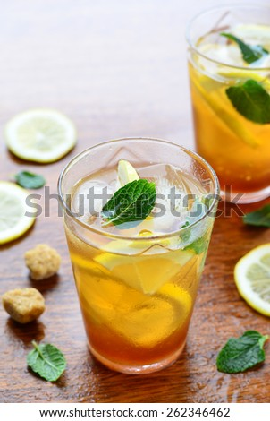 Lemon iced tea with mint and sugar cubes, vertical, selective focus  - stock photo