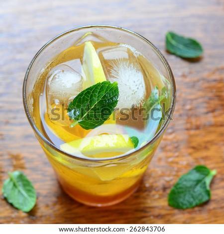 Lemon iced tea with mint, selective focus  - stock photo