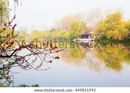 Lender west lake in spring. Slender west lake is a well-known scenic spot in China. It is situated in the northwest suburb of Yangzhou City.  It is a scenic area with many enchanting lake scenes. - stock photo