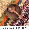 lentils, beans, peas, soybeans, legumes with wooden dish spoon background - stock photo