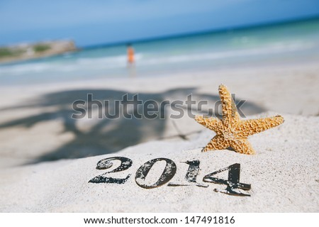 2014 letters numbers with starfish, ocean , beach and seascape, shallow dof - stock photo