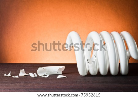 ,light bulb broken on wood, - stock photo