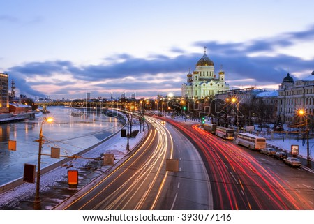 Light tracks of cars in Prechistenskaya waterfront on the background of Christ the Savior