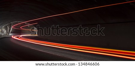 light trails in the tunnel. Art image . Long exposure photo taken in a tunnel below Veliko Tarnovo - stock photo