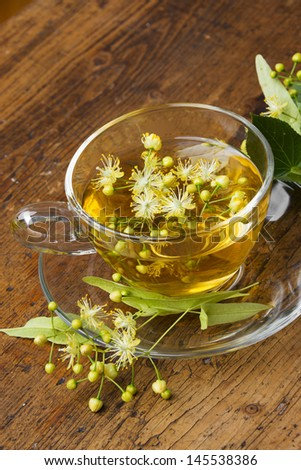 linden tea on an old wooden table - stock photo