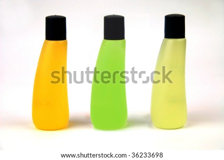 Line of three bottles with shower gel - stock photo