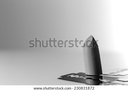 lip stick cut up with razer blade shot in the studio on white perspex background