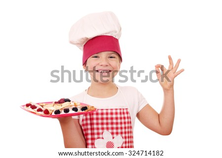 litlle girl with crepes on plate and ok hand sign - stock photo