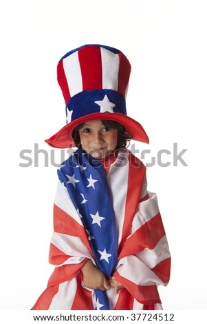 Littl boy dressed in a flag and hat from Uncle Sam - stock photo