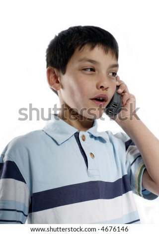 Little boy discussing important business on the phone - stock photo