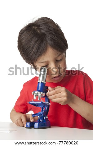 Little boy looking through a microscope on white background