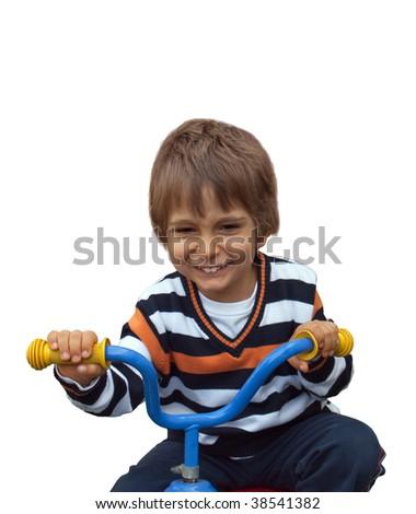 Little boy on a children's bike. - stock photo