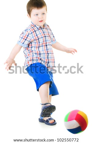 little boy playing ball on white background - stock photo