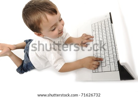 little boy sitting with laptop isolated on white - stock photo