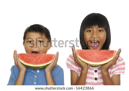 little couple eating watermelon - stock photo