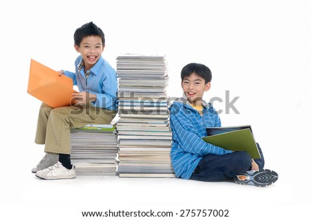 Little cute two boy with many books  - stock photo