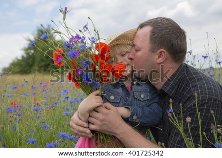 little girl giving flowers for father. - stock photo