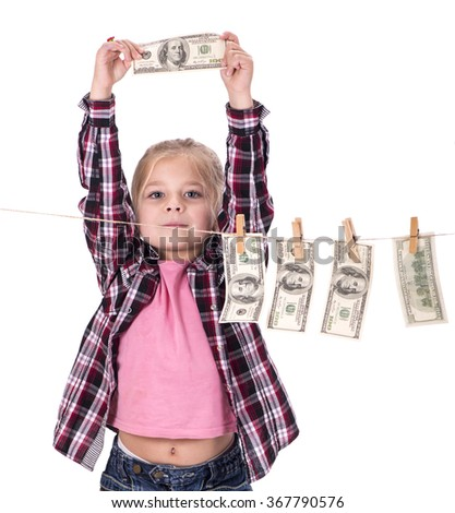 little girl is playing with paper money - dollars, isolated over white - stock photo