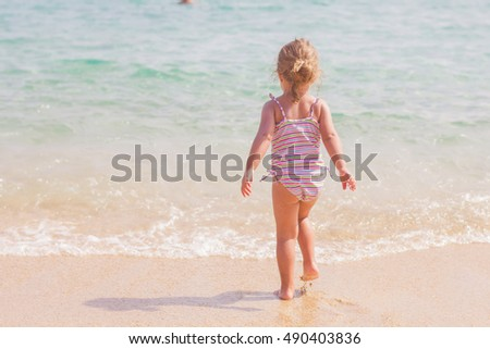 Little Girl on the sandy beach. Summer vacation.