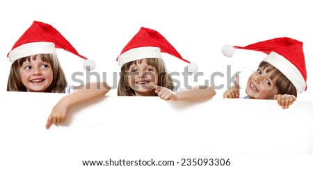 little girl with santa cap holding  white board - stock photo