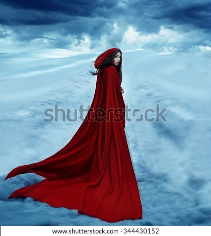 Little Red Riding Hood is going away on a snowy road. Dramatic and fantastic shooting,fashionable toning, creative computer colors - stock photo