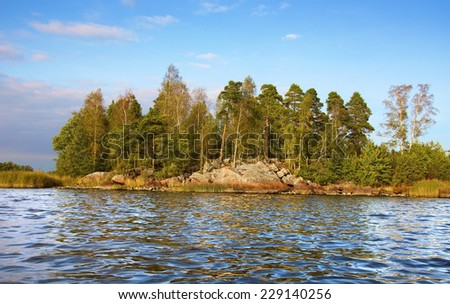 little rock island and  calm waves in Baltic sea, Vyborg bay                               - stock photo