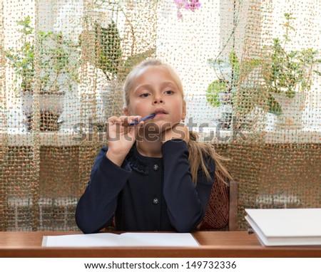 Little schoolgirl  at school - stock photo