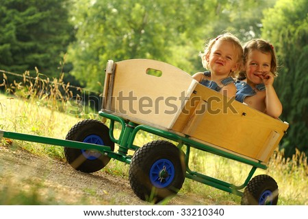2 Little sisters having fun - stock photo