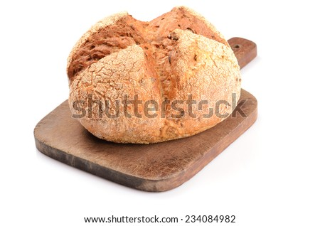 loaf of bread on a cutting board isolated on white - stock photo