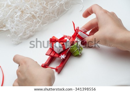 Located on a white background with snowflakes, gift box. Christmas gifts, sleighs, snowflakes, - stock photo