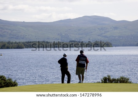 LOCH LOMOND, SCOTLAND - JUL 10 2009; Loch Lomond Scotland; Rodney Pampling (AUS) and his caddy admire the view from the 7th green during the second round of the PGA European Tour Barclays Scottish Open golf tournament.
