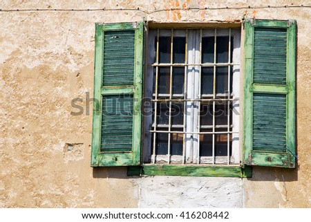 lonate ceppino varese italy abstract  window   green  wood venetian blind in the white